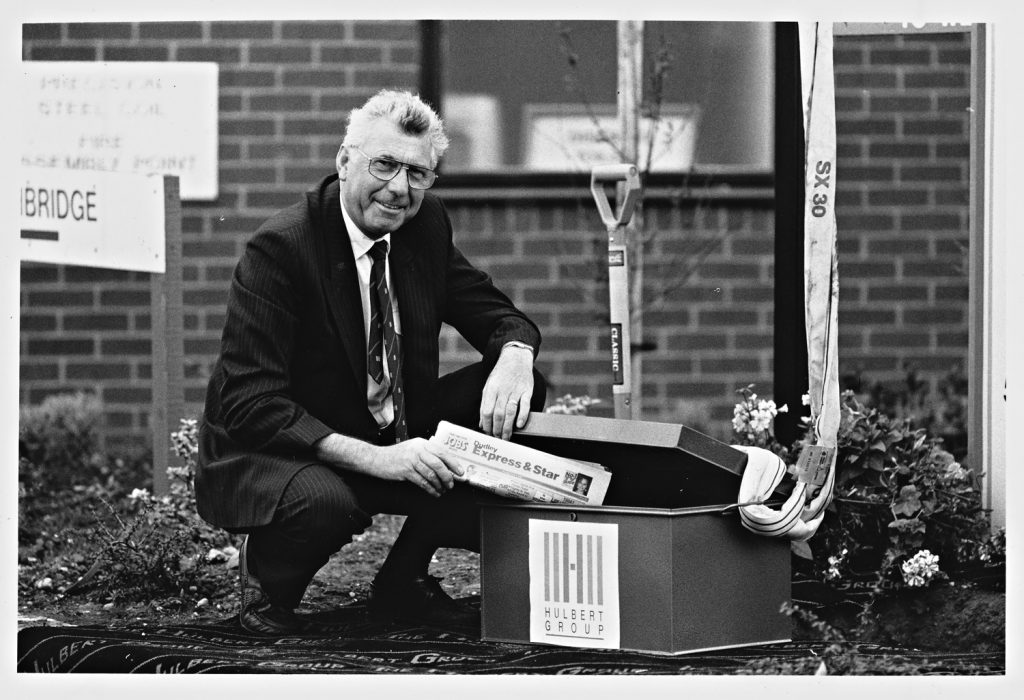 1990: Malcolm Woolley putting a copy of the Express & Star into a time capsule at the Hulbert Group, Dudley